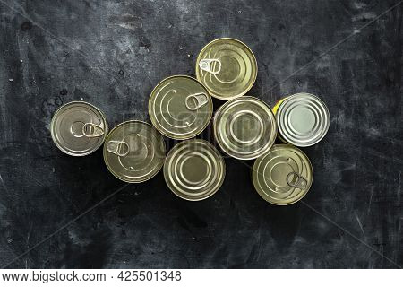 Many Unopened Tin Cans With Meals Such As Meat And Fish On The Table, Conserved Foods