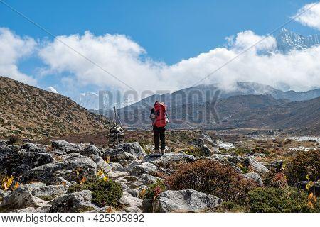 Back View Of Trekker Looking To Beautiful View Of Himalayas Mountain Range In Sagarmatha National Pa