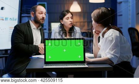 Mock Up Green Screen Chroma Key With Isolated Display Standing On Table Conference In Meeting Room.