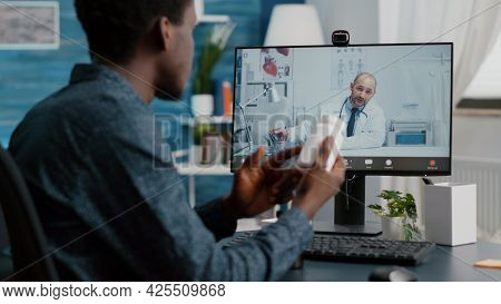 Black Man At Home Seeking Medical Help From Doctor Via Online Intenet Telehealth Consultation With F