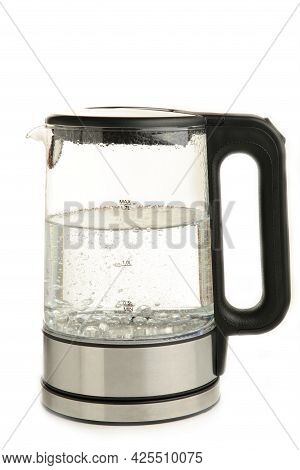 Side View Of Glass Electric Kettle With Water Isolated On White
