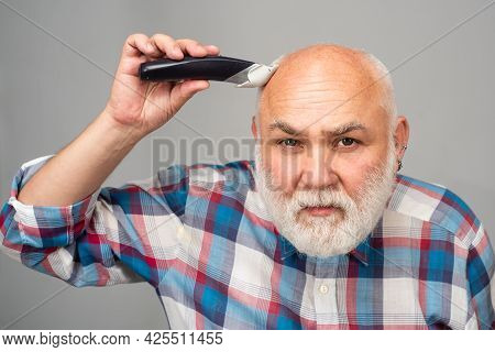 Bald Man Hairclipper, Mature Baldness And Hair Loss Concept. Middle Aged Gray Man.