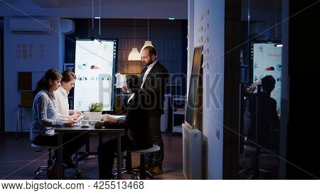 Frustrated Angry Businessman Screaming While Working Overtime In Company Meeting Room. Irritated Dis