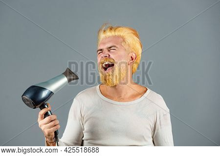 Crazy Stylish Man. Drying Hair Of A Young Funny Amazed Excited Bearded Man. Blonde Beard Man With Ha
