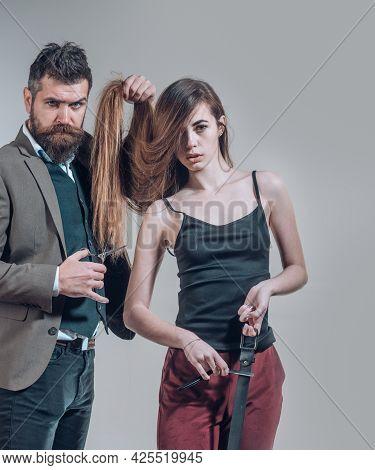 Hairdresser Making Hair Style, Fashion Haircut. Woman With Long Hair At Beauty Studio. Barber Cuttin