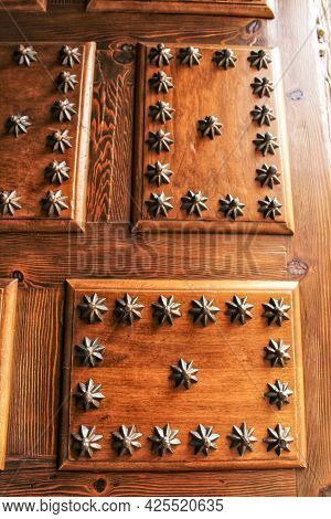 Old Wooden Door With Wrought Iron Details With The Shape Of A Star In Villanueva De Los Infantes Vil