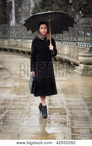 Confident Business Woman With Umbrella