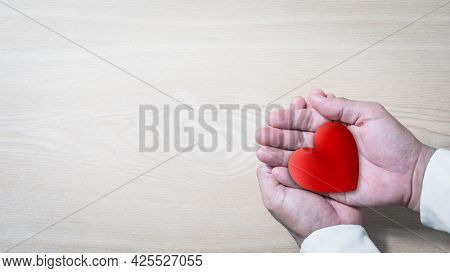 Hands Holding Red Heart, Health Care, Love, Organ Donation, Mindfulness, Wellbeing, Family Insurance