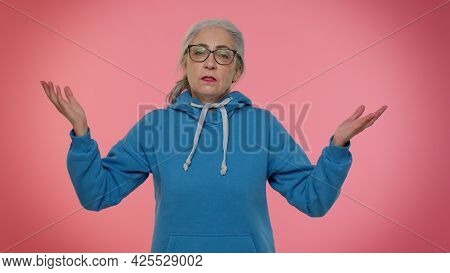 Why You Did It. What. Upset Frustrated Annoyed Elderly Woman Raising Hands In Indignant Expression,