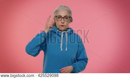 How Could You. Elderly Gray-haired Granny Woman Raising Hands In Indignant Expression, Asking Why, W