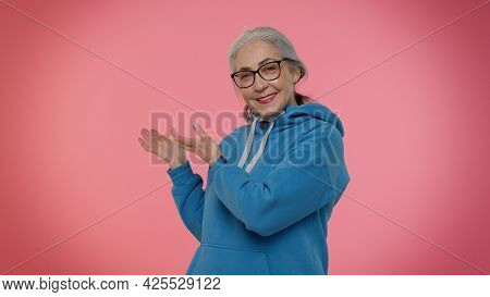 Come Here To Us. Elderly Good-looking Granny Woman Showing Inviting Gesture With Hands, Ask To Join,