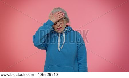 Upset Senior Old Granny Gray-haired Woman Making Face Palm Gesture, Feeling Bored, Disappointed In R