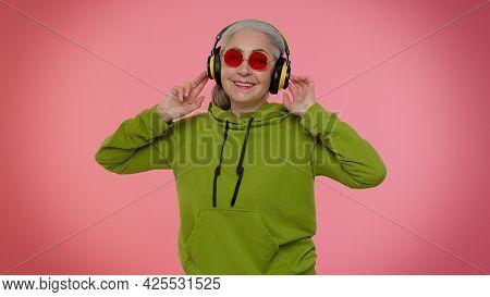 Senior Old Granny Stylish Woman Listening Music Via Headphones And Dancing Disco Fooling Around, Hav