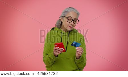 Senior Old Granny Stylish Woman Using Credit Bank Card And Smartphone While Transferring Money, Purc