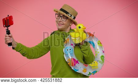 Mature Grandmother Traveler Blogger With Swimming Ring And Inflatable Duck Toy Taking Selfie On Mobi