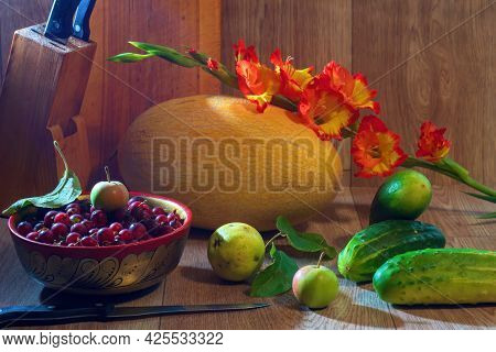 Still Life With Vegetables And Berries. Autumn Still Life With Melon Cucumbers Carrots And Gooseberr