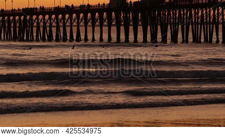 Wooden Pier Silhouette At Sunset, California Usa, Oceanside. Waterfront Surfing Resort, Pacific Ocea