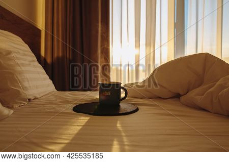 Cup Of Coffee In Bed At Sunrise. Dawn With A Cup Of Coffee In Bed. Hot Coffee In Bed. Waking Up With