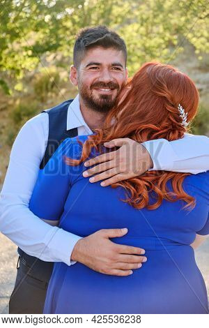 Turkish Man And His Beloved Caucasian Plus Size Red Headed Woman Embracing And Holding Hands. Mixed