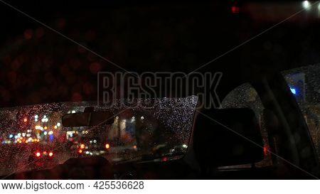 Defocused Evening Street, Blurred Bokeh. Lights Of City And Cars On Rainy Night. Reflection Of Elect
