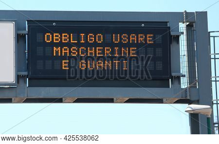 Text In Italian Language That Means Obligation To Use Mask And Glove During Lockdown