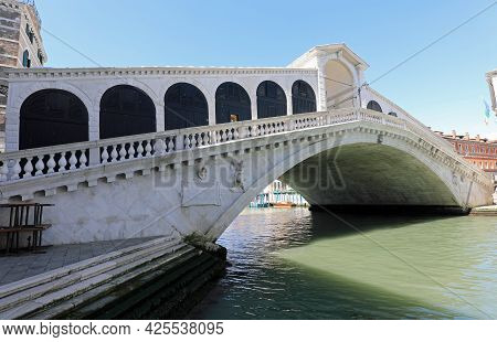 Famous Rialto Bridge Over The Main Waterway In Venice Called Canal Grande Without People During Lock
