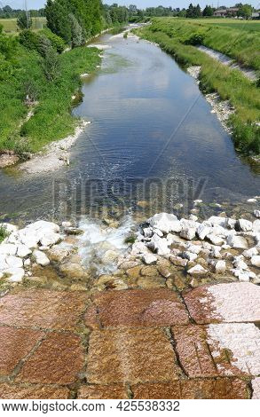 Riverbed Of The Timonchio River Near The City Of Vicenza In Northern Italy Without People