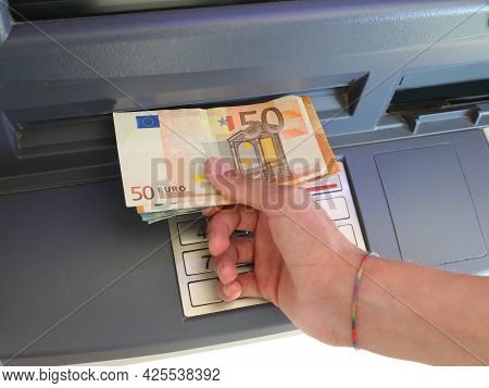 Hand Picking Up Banknotes In Europe From An Atm For Shopping