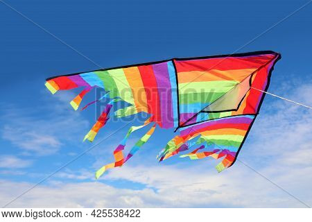 Big Kite With Bright Colors That Flies High In The Sky Symbol Of Freedom And Carefree