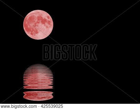 Reflection Sea Water Of An Incredible Big Red Moon And Midnight Black Starless Sky In The Background