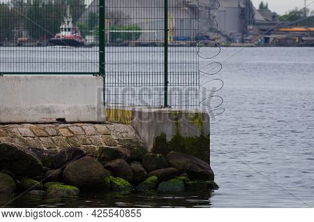 Protecting Site - Separating  Seaport With Fence And Razor Wire
