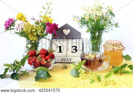 Calendar For July 13 : The Name Of The Month Of July In English, Cubes With The Number 13, Bouquets