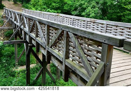 Medieval Oak Wood, Bolted. Bridge Over The Moat. The Railing Is Made Of Massive Beams, Between Which