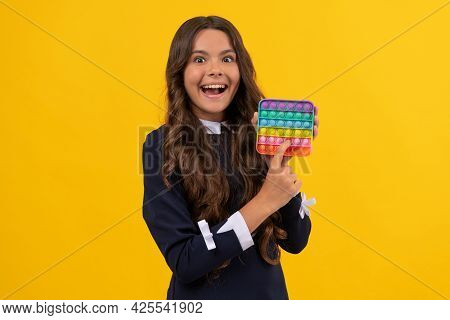 Sensory Fidgeting. Girl With Finger Game. Kid Popping Anti Stress Bubble. Childhood Craze.