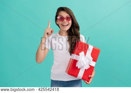 Shopping Final Sell Out. Teenage Shopper. Stylish Teen Girl In Sunglasses Hold Giftbox.
