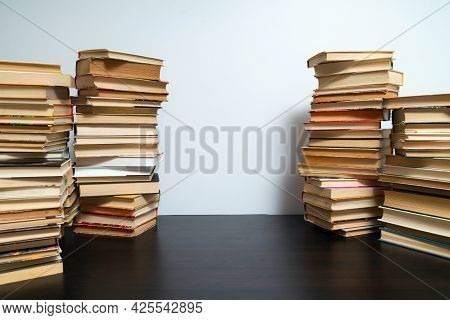 Big Stack Of Books On The Table. Studying Before The Exam. Pile Of Vintage Books. Concept Of Educati