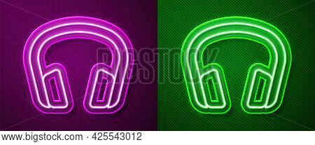 Glowing Neon Line Headphones Icon Isolated On Purple And Green Background. Earphones. Concept For Li