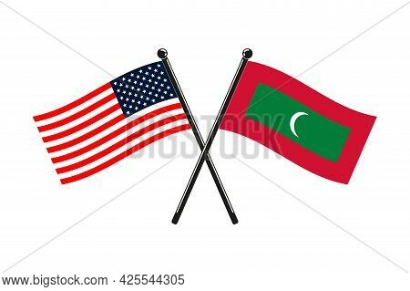 National Flags Of Maldives And Usa Crossed On The Sticks In The Original Colours