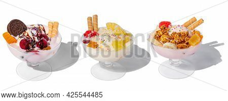 Many Ice Cream Bowls With Fresh Frozen Yogurt, Fruits, Cookies And Cherries Isolated On A White Back