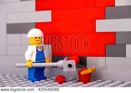 Tambov, Russian Federation - January 17, 2021 Lego Painter Minifigure Painting A Wall Red. Close-up.