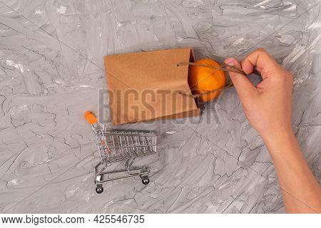 Shopping Cart With A Craft Bag, Buying Fruit Oranges.