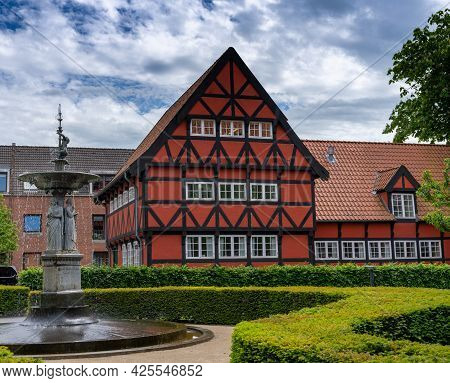 Aalborg, Denmark - 7 June, 2021: Historic Red Half-timbered House And The Kayerod Fountain In The Ol