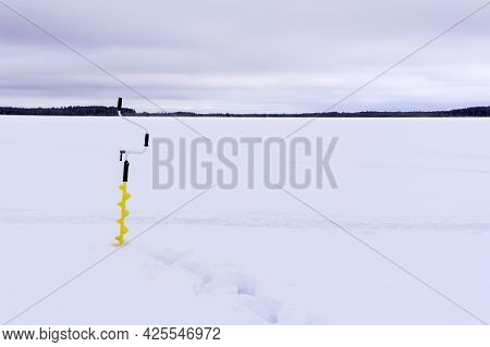 Equipment For Winter Fishing On The Ice. Drill For Winter Fishing. Space For Copying Text