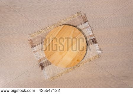 Template Wooden Dish Background On A Light Background. Space For Copying Text