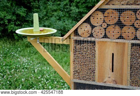 Insect Nest House Located In The Park On The Meadow. It Contains Porous Natural Materials Into Which