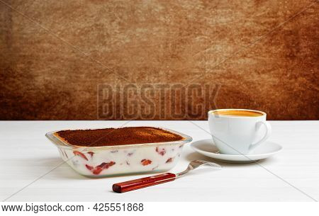 Homemade Tiramisu Dessert In A Glass Form And Cup Of Coffee On White Wooden Table. Copyspace. Tradit