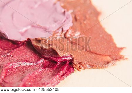 Close-up Smear Of Lipstick With Shimmery Particles On A Light Background. Texture Background For Bea