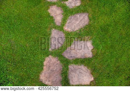 Landscaping Of The Garden Path Of Natural Rough Stone Along Which To Walk To Backyard And Go To The