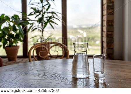 Water In Jug And Glass On Wooden Table In Vintage Style. Italian Restaurant Background For Your Desi
