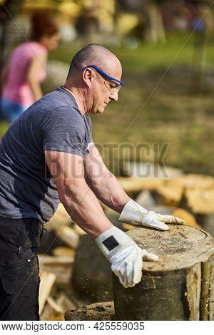 Strong Man Moving Big Cut Beech Logs